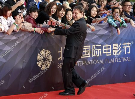 Us Film Director Sam Raimi Greets Fans During the Closing Ceremony Red Carpet Event of the 6th Beijing International Film Festival at the Beijing Yanqi Lake International Convention and Exhibition Center in Beijing China 23 April 2016 the Film Festival Ran From 16 to 23 April China Beijing
