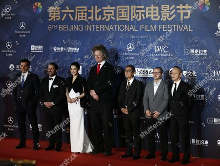 Tiantan Award Jury Members (l-r) Bosnian Director Danis Tanovic Us Director Brett Ratner Chinese Actress Xu Qing German Director Florian Henckel Von Donnersmarck Japanese Director Takita Yojiro Romanian Director Corneliu Porumboiu and Hong Kong Director Teddy Chan Arrive For the Opening Ceremony of the Beijing International Film Festival at the Beijing Yanqi Lake International Convention and Exhibition Center in Beijing China 16 April 2016 the Film Festival Will Run From 16 to 23 April China Beijing