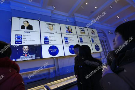 Visitors Look at an Electronic Screen Showing Details of Major Court Trials Including Those of Former Security Chief Zhou Yongkang (l) and Former Chongqing Communist Party Boss Bo Xilai (2-l) in the China Court Museum in Beijing China 22 January 2016 the China Court Museum Opened 06 January Showcasing the Country's Legal and Court System Over the Years Prominent on Display in the Main Hall Were Exhibits From Two of China's Most Politically Sensitive Trials of Former Security Chief Zhou Yongkang and Former Chongqing Communist Party Boss Bo Xilai Whose Dramatic Downfalls in Two Separate Unrelated Trials Gripped the Nation China Beijing