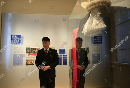 A Museum Staff Member is Seen Reflected in the Glass Panel of an Exhibit of a Judge's Robes at the China Court Museum in Beijing China 22 January 2016 the China Court Museum Opened 06 January Showcasing the Country's Legal and Court System Over the Years Prominent on Display in the Main Hall Were Exhibits From Two of China's Most Politically Sensitive Trials of Former Security Chief Zhou Yongkang and Former Chongqing Communist Party Boss Bo Xilai Whose Dramatic Downfalls in Two Separate Unrelated Trials Gripped the Nation China Beijing
