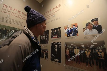A Visitor Looks at Pictures of Major Court Trials Exhibited at the China Court Museuml in Beijing China 22 January 2016 the China Court Museum Opened 06 January Showcasing the Country's Legal and Court System Over the Years Prominent on Display in the Main Hall Were Exhibits From Two of China's Most Politically Sensitive Trials of Former Security Chief Zhou Yongkang and Former Chongqing Communist Party Boss Bo Xilai Whose Dramatic Downfalls in Two Separate Unrelated Trials Gripped the Nation China Beijing