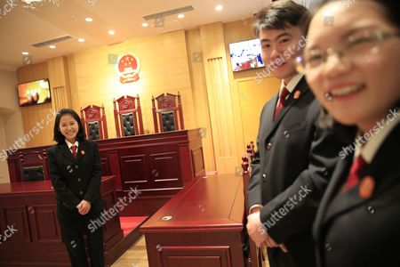 Stock Picture of Chinese Staff Members Are Seen in a Replica of a Chinese Court Room in an Exhibition Hall of the China Court Museum in Beijing China 22 January 2016 the China Court Museum Opened 06 January Showcasing the Country's Legal and Court System Over the Years Prominent on Display in the Main Hall Were Exhibits From Two of China's Most Politically Sensitive Trials of Former Security Chief Zhou Yongkang and Former Chongqing Communist Party Boss Bo Xilai Whose Dramatic Downfalls in Two Separate Unrelated Trials Gripped the Nation China Beijing