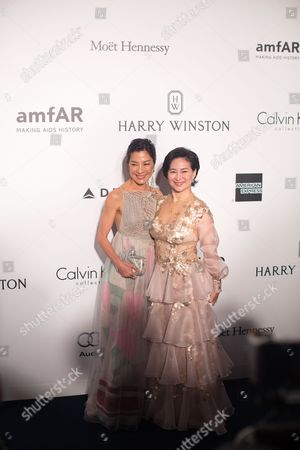 Malaysian-chinese Actress Michelle Yeoh (l) and Macau-born Businesswoman Pansy Ho Attend the Amfar Gala in Hong Kong China 19 March 2016 the American Foundation For Aids Research is Holding Its Second Hong Kong Fundraiser Event China Hong Kong