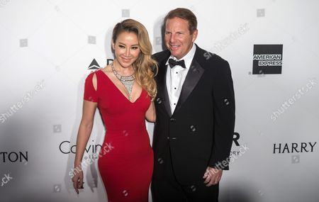 Hong Kong-born Singer Coco Lee (l) and Husband Bruce Rockowitz Attend the Amfar Gala in Hong Kong China 19 March 2016 the American Foundation For Aids Research is Holding Its Second Hong Kong Fundraiser Event China Hong Kong