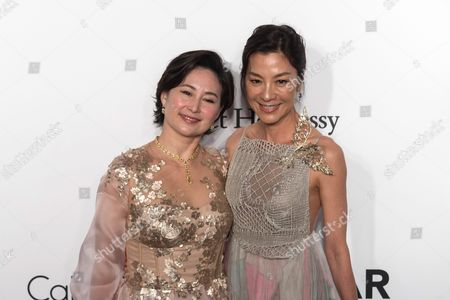 Malaysian-chinese Actress Michelle Yeoh (r) and Macau-born Businesswoman Pansy Ho Attend the Amfar Gala in Hong Kong China 19 March 2016 the American Foundation For Aids Research is Holding Its Second Hong Kong Fundraiser Event China Hong Kong