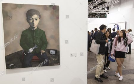 Stock Photo of An Art Piece by Chinese Artist Zhang Xiaogang Entitled 'Flashlight' is on Display on the Opening Day of Art Basel in Hong Kong China 22 March 2016 According to the Organizer 239 of the World's Leading Modern and Contemporary Art Galleries Half of Which Are From Asia Gathered to Display Paintings Drawings Sculptures Installations Prints Photography Film Video and Digital Art by Over 4 000 Artists As the Main Stay of the Hong Kong Art Week Art Basel Collaborates with Local and International Partners on a Range of Arts Programming with Many Cultural Events Hosted Across the City Throughout the Week China Hong Kong