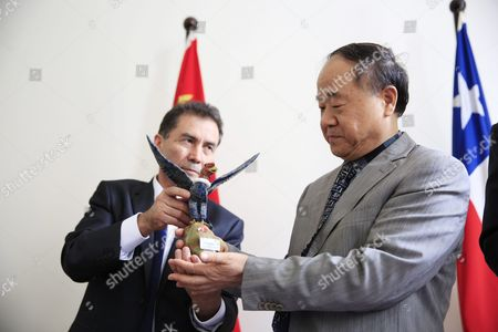 Chinese Writer and 2012 Nobel Prize Winner in Literature Mo Yan (r) is Presented with a Gift From Director of the Chile-china Culture Institute Juan Carlos Ramirez (l) During a Signing Ceremony at the Embassy of Chile in Beijing China 31 May 2016 Mo Signed an Agreement with Ramirez During the Ceremony to Adapt His Novel 'Life and Death Are Wearing Me Out' Into a Spanish Stage Play China Beijing