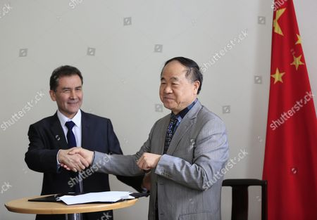 Chinese Writer and 2012 Nobel Prize Winner in Literature Mo Yan (r) and Director of the Chile-china Culture Institute Juan Carlos Ramirez (l) Shake Hands During a Signing Ceremony at the Embassy of Chile in Beijing China 31 May 2016 Mo Signed an Agreement with Ramirez During the Ceremony to Adapt His Novel 'Life and Death Are Wearing Me Out' Into a Spanish Stage Play China Beijing