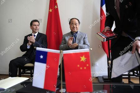 Chinese Writer and 2012 Nobel Prize Winner in Literature Mo Yan (c) and Director of the Chile-china Culture Institute Juan Carlos Ramirez (l) Applaud During a Signing Ceremony at the Embassy of Chile in Beijing China 31 May 2016 Mo Signed an Agreement with Ramirez During the Ceremony to Adapt His Novel 'Life and Death Are Wearing Me Out' Into a Spanish Stage Play China Beijing