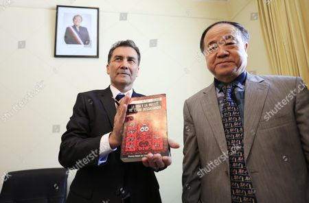 Stock Picture of Chinese Writer and 2012 Nobel Prize Winner in Literature Mo Yan (r) and Director of the Chile-china Culture Institute Juan Carlos Ramirez (l) Pose For a Photo with the Spanish Translation of Mo Yan's Novel 'Life and Death Are Wearing Me Out' During a Press Conference at the Embassy of Chile in Beijing China 31 May 2016 Mo Signed an Agreement with Ramirez During the Ceremony to Adapt His Novel 'Life and Death Are Wearing Me Out' Into a Spanish Stage Play China Beijing