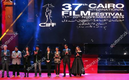 The Festival's International Jury (l-r) British Producer Paul Webster Peruvian Filmmaker Jonathan Relayze Chiang Belgian-born Producer Anne-dominique Toussaint Georgian Director George Ovashvili Moroccan Writer-director Laila Marrakchi Indian Actress Radhika Apte Egyptian Director Marwan Hamed and Egyptian Actress Dalia El Behery Gather on Stage During the Opening Ceremony of the 37th Cairo International Film Festival (ciff) in Cairo Egypt 11 November 2015 the Ciff Runs From 11 to 20 November Egypt Cairo