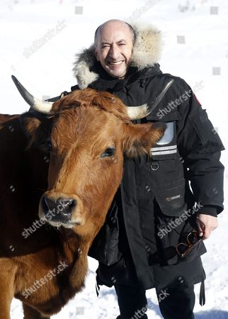 French Actor Fatsah Bouyahmed Poses with a Cow During the Photocall For 'La Vache' at the 19th Annual International Comedy Film Festival in L'alpe D'huez France 15 January 2016 the Festival Runs From 13 to 17 January France Alpe D'huez