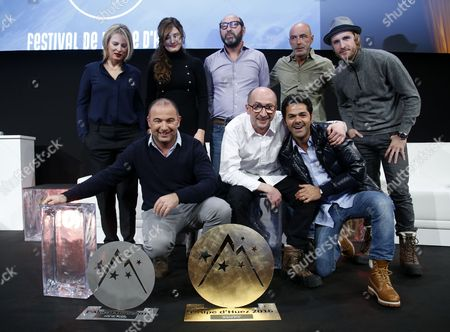 French Actors and Members of Jury Karin Viard (back-l) Alice Pol (back 2-l) Kad Merad (back-c) Patrick Bosso (back 2-r) Philipp Lacheau (back-r) and French Director Mohamed Hamidi (l) French Actors Fatsah Bouyahmed (c) and Jamel Debbouze (r) Pose with the 'Ocs Festival De L'alpe D'huez 2015' Prize 'Public' Prize and 'The Best Actor Award Michel Galabru' For Their Movie 'La Vache' During the Closing Ceremony of the 18th Annual International Comedy Film Festival in L'alpe D'huez France 16 January 2016 France Alpe D'huez