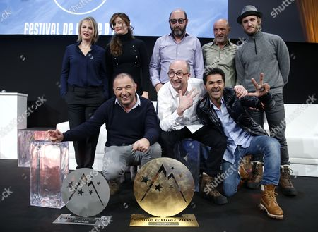 Stock Picture of French Actors and Members of Jury Karin Viard (back-l) Alice Pol (back 2-l) Kad Merad (back-c) Patrick Bosso (back 2-r) Philipp Lacheau (back-r) and French Director Mohamed Hamidi (l) French Actors Fatsah Bouyahmed (c) and Jamel Debbouze (r) Pose with the 'Ocs Festival De L'alpe D'huez 2015' Prize 'Public' Prize and 'The Best Actor Award Michel Galabru' For Their Movie 'La Vache' During the Closing Ceremony of the 18th Annual International Comedy Film Festival in L'alpe D'huez France 16 January 2016 France Alpe D'huez