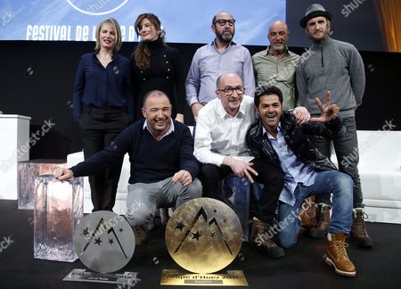 Stock Photo of French Actors and Members of Jury Karin Viard (back-l) Alice Pol (back 2-l) Kad Merad (back-c) Patrick Bosso (back 2-r) Philipp Lacheau (back-r) and French Director Mohamed Hamidi (l) French Actors Fatsah Bouyahmed (c) and Jamel Debbouze (r) Pose with the 'Ocs Festival De L'alpe D'huez 2015' Prize 'Public' Prize and 'The Best Actor Award Michel Galabru' For Their Movie 'La Vache' During the Closing Ceremony of the 18th Annual International Comedy Film Festival in L'alpe D'huez France 16 January 2016 France Alpe D'huez