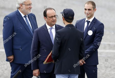 French President Francois Hollande (center-l) Greets Charly Coudroux (front-c) a Young Member of Service Civique During the Traditional Military Parade As Part of the Bastille Day Celebrations in Paris France 14 July 2015 the Bastille Day the French National Day is Held Annually on 14 July to Commemorate the Storming of the Bastille Fortress in 1789 France Paris