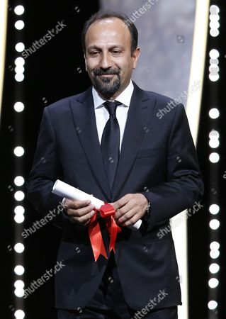 Iranian Director Ashgar Farhadi Receives the Best Screenplay Award For His Movie 'Forushande' (the Salesman) During the Closing Award Ceremony of the 69th Cannes Film Festival in Cannes France 22 May 2016 For the First Time in the Festival History the Golden Palm Winning Movie Will Be Screened at the Closing Ceremony France Cannes