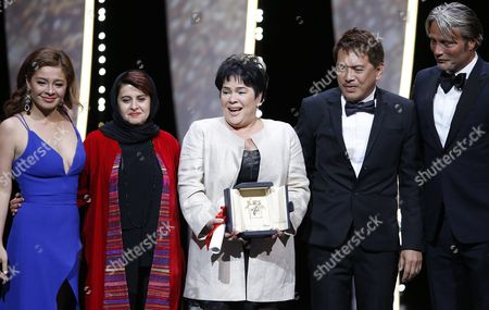 Philippino Actress Jaclyn Jose (c) Receives the Best Performance by an Actress Award For 'Ma'rosa' As Philippino Actress Andi Eigenmann (l) Philippino Director Brillante Mendoza (2-r) Iranian Producer Katayoon Shahabi (2-l) and Danish Actor Mads Mikkelsen (r) Look on During the Closing Award Ceremony of the 69th Cannes Film Festival in Cannes France 22 May 2016 For the First Time in the Festival History the Golden Palm Winning Movie Will Be Screened at the Closing Ceremony France Cannes