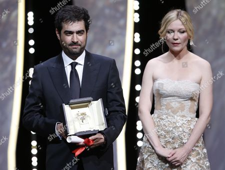 Iranian Actor Shahab Hosseini Reacts As He Receives the Best Performance by an Actor Award For 'Forushande' (the Salesman) From Us Actress Kirsten Dunst (r) During the Closing Award Ceremony of the 69th Cannes Film Festival in Cannes France 22 May 2016 For the First Time in the Festival History the Golden Palm Winning Movie Will Be Screened at the Closing Ceremony France Cannes