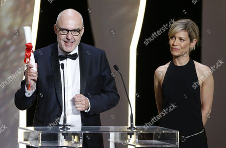 Spanish Director Juanjo Gimenez (l) Receives the Best Short Film Award For 'Timecode' From French Actress Marina Fois (r) During the Closing Award Ceremony of the 69th Cannes Film Festival in Cannes France 22 May 2016 For the First Time in the Festival History the Golden Palm Winning Movie Will Be Screened at the Closing Ceremony France Cannes