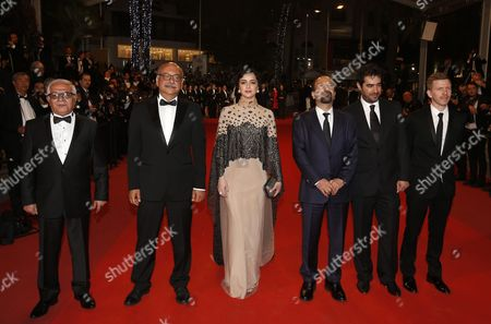 (l-r) Iranian Actor Farid Sajjadihosseini Iranian Actor Babak Karimi Iranian Actress Taraneh Alidoosti Iranian Director Ashgar Farhadi Iranian Actor Shahab Hosseini and French Producer Alexandre Mallet-guy Arrive For the Screening of 'Forushande' (the Salesman) During the 69th Annual Cannes Film Festival in Cannes France 21 May 2016 the Movie is Presented in the Official Competition of the Festival Which Runs From 11 to 22 May France Cannes