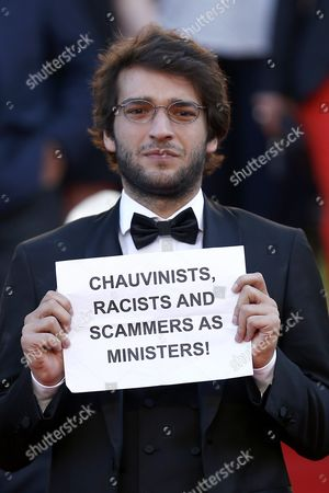 Brazilian Actor Humberto Carrao Holds a Sign Reading 'Chauvinists Racists and Scammers As Ministers!' As He Leaves After the Screening of 'Aquarius' During the 69th Annual Cannes Film Festival in Cannes France 17 May 2016 the Movie was Presented in the Official Competition of the Festival Which Runs From 11 to 22 May France Cannes