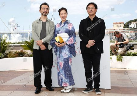 Stock Image of (l-r) Japanese Actor Kanji Furutachi Japanese Actress Tsutsui Mariko and Japanese Director Koji Fukada Pose During the Photocall For 'Fuchi Ni Tatsu' (harmonium) at the 69th Annual Cannes Film Festival in Cannes France 14 May 2016 the Movie is Presented in the Section Un Certain Regard of the Festival Which Runs From 11 to 22 May France Cannes