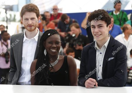 Stock Image of (l-r) Belgian Actor Olivier Bonnaud Burkina Faso Actress Nadege Ouedraogo and Belgian Actor Louka Minnella Pose During the Photocall For 'La Fille Inconnue' (the Unknown Girl) at the 69th Annual Cannes Film Festival in Cannes France 18 May 2016 the Movie is Presented in the Official Competition of the Festival Which Runs From 11 to 22 May France Cannes