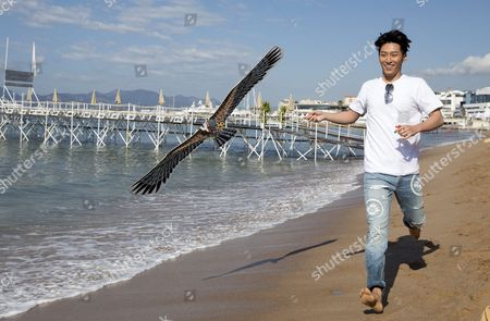 Stock Photo of Chinese Actor Shawn Dou Flies a Kite on the Beach During a Photocall For 'The Last Race' at the 69th Annual Cannes Film Festival in Cannes France 15 May 2016 the Festival Runs From 11 to 22 May France Cannes