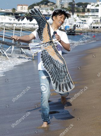 Chinese Actor Shawn Dou Flies a Kite on the Beach During a Photocall For 'The Last Race' at the 69th Annual Cannes Film Festival in Cannes France 15 May 2016 the Festival Runs From 11 to 22 May France Cannes