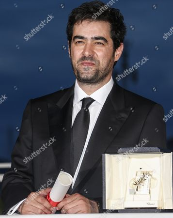 Iranian Actor Shahab Hosseini Poses with His Best Performance by an Actor Award For 'Forushande' (the Salesman) During the Award Winners Photocall at the 69th Annual Cannes Film Festival in Cannes France 22 May 2016 France Cannes