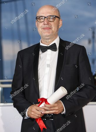 Spanish Director Juanjo Gimenez Poses with the Best Short Film Award For 'Timecode' During the Award Winners Photocall at the 69th Annual Cannes Film Festival in Cannes France 22 May 2016 France Cannes