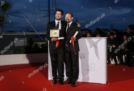 Iranian Director Ashgar Farhadi (r) and Iranian Actor Shahab Hosseini (l) Pose During the Award Winners Photocall After They Won the Best Screenplay Award and the Best Performance by an Actor Award For the Movie 'Forushande' (the Salesman) at the 69th Annual Cannes Film Festival in Cannes France 22 May 2016 France Cannes