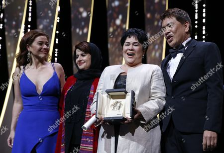 Philippino Actress Jaclyn Jose (2-r) Receives the Best Performance by an Actress Award For 'Ma'rosa' As Philippino Actress Andi Eigenmann (l) Philippino Director Brillante Mendoza (r) and Iranian Producer Katayoon Shahabi (2-l) Look on During the Closing Award Ceremony of the 69th Cannes Film Festival in Cannes France 22 May 2016 For the First Time in the Festival History the Golden Palm Winning Movie Will Be Screened at the Closing Ceremony France Cannes