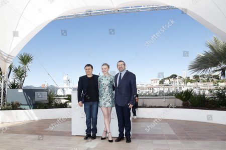 Stock Picture of (l-r) Romanian Director Cristian Mungiu Romanian Actress Maria Dragus and Romanian Actor Adrian Titieni Pose During the Photocall For 'Bacalaureat' at the 69th Annual Cannes Film Festival in Cannes France 19 May 2016 the Movie is Presented in the Official Competition of the Festival Which Runs From 11 to 22 May France Cannes