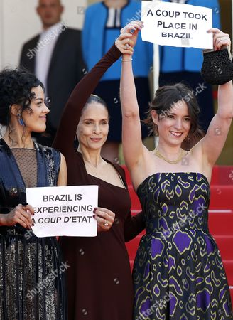 (l-r) Brazilian Actress Maeve Jinkings Brazilian Actress Sonia Braga and Producer Emilie Lesclaux Hold Signs Reading 'A Coup Took Place in Brazil' and 'Brazil is Experiencing a Coup D'etat' As They Arrive For the Screening of 'Aquarius' During the 69th Annual Cannes Film Festival in Cannes France 17 May 2016 the Movie is Presented in the Official Competition of the Festival Which Runs From 11 to 22 May France Cannes