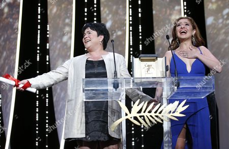 Stock Image of Philippino Actress Jaclyn Jose (l) Receives the Best Performance by an Actress Award For 'Ma'rosa' As Philippino Actress Andi Eigenmann (r) Looks on During the Closing Award Ceremony of the 69th Cannes Film Festival in Cannes France 22 May 2016 For the First Time in the Festival History the Golden Palm Winning Movie Will Be Screened at the Closing Ceremony France Cannes