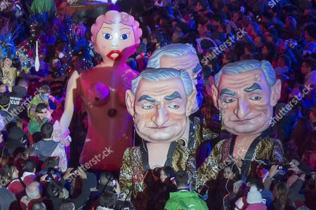 People Wearing Giant Puppet Costumes Depicting French Former Imf Head and Politician Dominique Strauss-kahn Parade During the 2016 Nice Carnival in Nice France 13 February 2016 the 2016 Nice Carnival Runs From 13 to 18 February and the Theme Will Be 'King of Media' France Nice