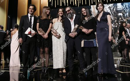 Australian Composer Warren Ellis (c) Poses After Winning the Best Original Score Award For 'Mustang' Alongside Turkish Director Deniz Gamze Erguven who Won the Award For the Best First Feature Film For Her Film 'Mustang' (3-l) Writer Alice Winocour (2-l) and Editor Mathilde Van De Moortel (2-r) Pose After Receiving Thier Awards During the 41st Annual Cesar Awards Ceremony Held at the Chatelet Theatre in Paris France 26 February 2016 France Paris