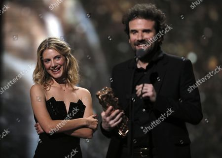 French Actress Melanie Laurent (l) Smiles As French Director Cyril Dion (r) Accepts the Best Documentary Feature Award For 'Demain' (tomorrow) During the 41st Annual Cesar Awards Ceremony Held at the Chatelet Theatre in Paris France 26 February 2016 France Paris