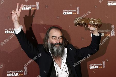 Stock Picture of Australian Musician and Composer Warren Ellis Poses with the Best Original Soundtrack Award For 'Mustang' During the 41st Annual Cesar Awards Ceremony Held at the Chatelet Theatre in Paris France 26 February 2016 France Paris