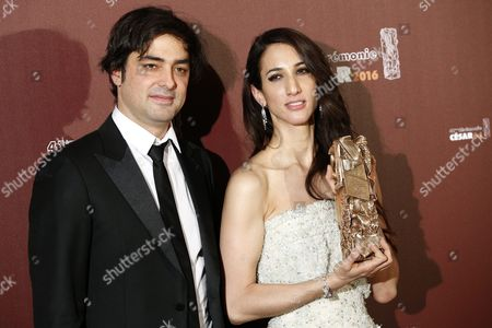 French Producer Charles Gillibert (l) and Turkish Director Deniz Gamze Erguven (r) Pose with the Best First Film Award For 'Mustang' During the 41st Annual Cesar Awards Ceremony Held at the Chatelet Theatre in Paris France 26 February 2016 France Paris
