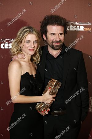 Stock Image of French Actress and Director Melanie Laurent and French Director Cyril Dion Pose with the Best Documentary Film Award For 'Demain' (tomorrow) During the 41st Annual Cesar Awards Ceremony Held at the Chatelet Theatre in Paris France 26 February 2016 France Paris