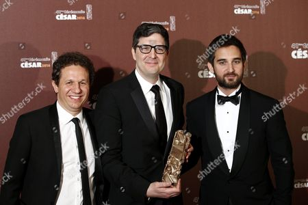 Us Director Mark Osborne (c) Flanked by French Producer Dimitri Rassam (r) and Producer Aton Soumache (l) Poses with the Best Animated Film Award For 'Le Petit Prince' (the Little Prince) During the 41st Annual Cesar Awards Ceremony Held at the Chatelet Theatre in Paris France 26 February 2016 France Paris