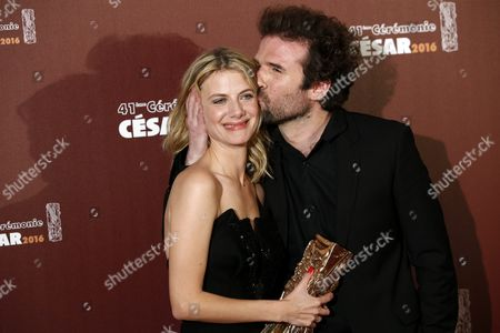 Stock Picture of French Actress and Director Melanie Laurent and French Director Cyril Dion Pose with the Best Documentary Film Award For 'Demain' (tomorrow) During the 41st Annual Cesar Awards Ceremony Held at the Chatelet Theatre in Paris France 26 February 2016 France Paris