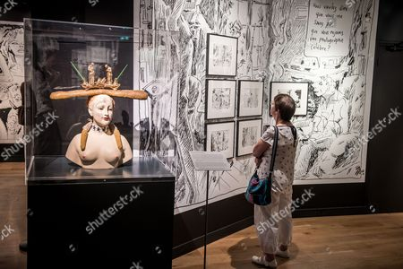 Stock Photo of A Visitor Looks at Drawings and Sketches by French Cartoonist Joann Sfar on Display Surrounded by Sculptures and Objects by Salvador Dali During the Exhibition 'Joann Sfar - Salvador Dali Une Seconde Avant L'eveil' (joann Sfar - Salvador Dali One Second Before Awakening) Held at the Espace Dali in Paris France 08 September 2016 the Sketches on Display in the Exhibition Are Extracted From a Comic Book Tribute by Sfar to Dali Entitled 'Fin De La Parenthese' Which Will Be on Sale Mid-september 2016 France Paris