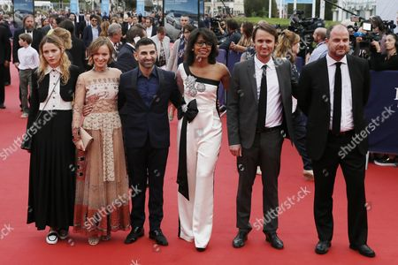 (l-r) the Members of the Revelation Jury French Actress Christa Theret French Actress Diane Rouxel French Born Iranian Actor Comedian Kheiron French Journalist Jury Audrey Pulvar French Scenarist Moviemaker Jerome Bonnell and French Scenarist Moviemaker Jury Cedric Anger Arrive on the Red Carpet Prior to the Opening Ceremony and the Screening of 'Infiltrator' During the 41st Deauville American Film Festival in Deauville France 02 September 2016 the Festival Runs From 02 to 11 September France Deauville