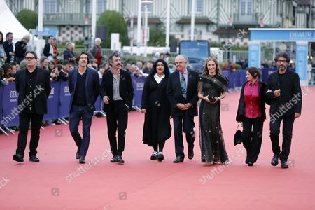 (l-r) Members of the Jury Us Writer Douglas Kennedy French Filmmaker Emmanuel Mouret French Actor Eric Elmosnino Iranian-french Writer Marjane Satrapi Former French Culture Minister Frederic Mitterrand French Actress Ana Girardot French Actress Francoise Arnoul and French Romanian-born Director Radu Mihaileanu Arrive on the Red Carpet Prior to the Premiere of 'Hell Or High Water' During the 42nd Deauville American Film Festival in Deauville France 05 September 2016 the Festival Runs From 02 to 11 September France Deauville