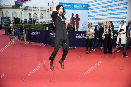 Stock Photo of Us Actor and Film Director Jason Lew Arrives on the Red Carpet Prior to the Homage For Us Film Director Michael Moore During the 42nd Deauville American Film Festival in Deauville France 04 September 2016 the Festival Runs From 02 to 11 September France Deauville
