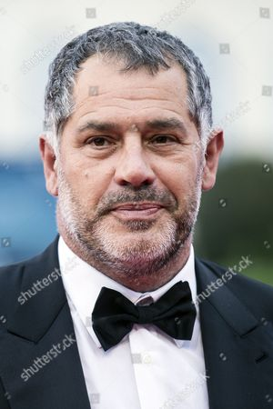 Stock Photo of French Film Director Luc Jacquet Arrives on the Red Carpet Prior to the Homage For Us Film Director Michael Moore During the 42nd Deauville American Film Festival in Deauville France 04 September 2016 the Festival Runs From 02 to 11 September France Deauville